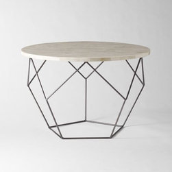 Origami Coffee Table   West Elm - This Origami coffee table with natural bone tiles is visually stunning, and its unique design makes it versatile. I would use it as a side or coffee table.
