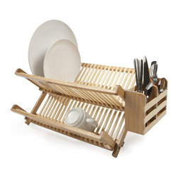 Dry & Hide Bamboo Dish Rack - The Dry & Hide Bamboo Dish Rack is made from 100% organically grown bamboo that adds beautiful durability to any kind of kitchen. Don't have counter space to spare? No problem! This piece folds down for clean and easy storage. Whether you use it for storing dishes or for air drying, this piece adds stylish functionality to any kitchen décor.