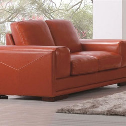Diamond Sofa - Define Loveseat - Orange - Square Track Arm. Polydacron, Polyester Fibers. Sleek, Clean Lines. Two Over Two Design. Attached Seat & Back Cushions. Hardwood Frame with Lifetime Warranty. No Assembly Required. 69 in. L x 39 in. W x 30 in. H (128 lbs.)The Define Collection by Diamond Sofa where sleek style meets inviting comfort. This luxurious piece offers a stunning look that will instantly enhance any space with its crisp clean lines and two over two design to offer the perfect combination of sophisticated modern styling. Topped with a plush, deep sit, this collection is bursting with straight lines, cool character and fresh contemporary style. The Coral Orange top grain leather Define Loveseat features a kiln-dried hardwood frame that is glued and reinforced, offers strength, while the zig zag spring suspension base gives you a supple seating that will hold up for years. The elastic webbing back suspension offers additional stability. Seat cushions are comprised of a high density foam cushion wrapped in polyester fibers to ensure a comfortable, relaxing and lasting seat. Seat cushions and back pillows are attached to the frame to eliminate shifts or gaps and ensure years of comfort and enjoyment.