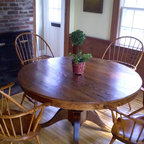Reclaimed wood dining tables - Custom round ding table with single pedestal. This table was made from reclaimed wood and hand selected Tiger Maple. It is available in custom sizes and different woods.