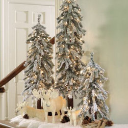 Martha Stewart Pre-Lit Flocked Alpine Tree - I love this alpine tree. It would go great in a corner on the floor or on a table setting, as seen in the picture. The best part is that it's pre-lit.