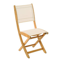 Frontgate - Set of Two Sillage Outdoor Teak and Sling Folding Chairs - Frame is responsibly crafted from beautiful Tropical Forest Trust (TFT)-certified plantation teak wood. With an Ash, Black or Off-White Batyline sling seat and back. Natural, unfinished teak has a fine-sanded finish and will weather to a beautiful silver/gray patina. Rust- and corrosion-resistant 304 stainless steel fittings. Coordinates with our Origami Teak Extension Table. Our most popular folding chair, the Set of Two Sillage Teak and Sling Folding Chairs combines classic kiln-dried teak with a comfortable, quick-drying Batyline sling seat and back. For easy storage, the stool is freestanding, even when folded.. . . . .