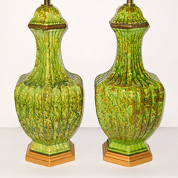 Hollywood Regency Pottery Lamps with a Green Lava Drip Glaze by Retro Symphony - I would want to use this very hip and very cool lamp pair in a bachelor pad. Couldn't you see them on either side of a large black Parsons table in an entry? Or maybe in a bedroom paired with lots of deep wood tones and a leather chair?