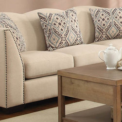 Coaster - Siana Taupe Linen Sofa - This elegant collection features a vintage inspired style that will add a touch of French laundry flair to your living room. Scalloped top and tight back cushions create a contoured look, framed by beautiful arms with classic nail head trim. Taupe linen upholstery is accented with throw pillows in an ikat patterned fabric, creating just the right blend of modern and old-world.