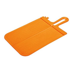 """Koziol - Flipp Cutting Board - Never spill chopped vegetables again with Flipp Chopping Board. This smart board folds in half to create a chute, funneling vegetables safely to the pan, plate or salad bowl. Designed by: Thomas Junk & Franziska Fuchs Features: -Made from solid color recyclable plastic. -Tapered edge on the handle for easy gripping. -Flipp folding chopping board has a hole in the handle so it can be hung. -Dishwasher safe. -Dimensions: 0.33"""" H x 9.53"""" W x 18.27"""" D."""