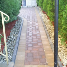 Traditional Landscape by MC GREENFIELD LANDSCAPING LLC