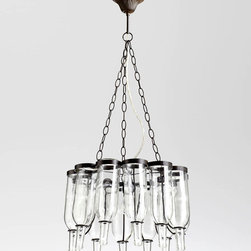 Winey Chandelier - It captivates like the appurtenances of trattorias in Italy that exude  la dolce vita in everything from fine wine to magnificent frescoes. The Winey 1-Light Chandelier features 12 wine bottles elegantly suspended from circular holders finished in glimmering bronze. A single bulb at the center allows for the light's gentle illumination to be reflected within the sparkling glass of each bottle.