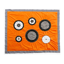 "Teyo's Tires - Medium Quilt - Teyo's Tires coordinating quilt is one of the most requested quilts around.  Soft minky on both sides make this the perfect blanket anytime and anywhere!  Orange minky on both sides trimmed in ""Sheet Metal"" cotton print fabric. Detailed applique's of Teyo's actual ""Tires"" throughout the front of this one of a kind quilt.  Not only does this quilt coordinate with the entire set you can also enjoy using this outside the crib and for years to come!  Also available in sets!"