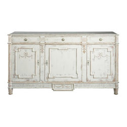 Daniel Sideboard - This beautiful sideboard is a replica of an 18th century Swedish antique. Its whitewashed finish gives the large piece a softer feel, and the three doors and drawers are perfect for storing serving pieces and china. Plus, its 40-inch height makes it a focal point in a room. It's just begging for a beautiful piece of art to be hung above it.