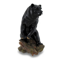 Zeckos - Black Bear On Rocks Glossy Finish Statue - Resting on a rocky seat, this solitary hunter seemingly takes a look around as he scans his environment from any shelf, tabletop or desk in your home or at the office. This cast resin 9.5 inch high, 4.5 inch long, 5 inch wide (24 X 11 X 13 cm) glossy black bear boasts a hand-painted finish showing off his muscular form, and makes a wonderful gift any hunter or animal lover is sure to admire