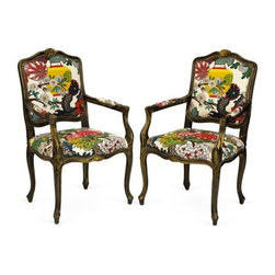 A Pair of Schumacher Dragon Chairs - These traditional French chairs have been upgraded with a whimsical Schumacher's bold-hued Chaing Mai Dragon print.  Complete with a hand painted black and gold distressed finish and decorative nailheads along the bottom of the seat.  Seat height of 19''