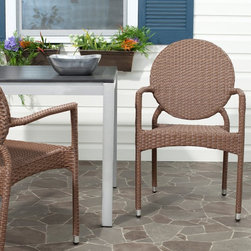 Safavieh - Safavieh Valdez Stackable Dining Chair - Set of 2 - FOX5205A-SET2 - Shop for Chairs and Sofas from Hayneedle.com! Whereas midcentury modernism railed against natural aesthetic prioritizing clean lines and stark contrasts; contemporary design such as that found in the Safavieh Valdez Stackable Dining Chair - Set of 2 has reembraced the natural merging it with those cool constructions of the moderns for a more organic whole. The clean-lined design of these intriguing outdoor side chairs is topped by a unique round backrest that creates a geometric balance reminiscent of a Maholy-Nagy composition. However the soft look of the PE wicker and the durability of the aluminum making them ideal outdoor seating reinsert a natural feel that makes them at once entirely contemporary and timeless.About SafaviehConsidered the authority on fine quality craftsmanship and style since their inception in 1914 Safavieh is most successful in the home furnishings industry thanks to their talent for combining high tech with high touch. For four generations the family behind the Safavieh brand has dedicated its talents and resources to providing uncompromising quality. They hold the durability beauty and artistry of their handmade rugs well-crafted furniture and decorative accents in the highest regard. That's why they focus their efforts on developing the highest quality products to suit the broadest range of budgets. Their mission is perpetuate the interior furnishings craft and lead with innovation while preserving centuries-old traditions in categories from antique reproductions to fashion-forward contemporary trends.