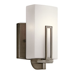 Kichler 1-Light Wall Fixture - Shadow Bronze - One Light Wall Fixture This 1 light wall sconce from the soft contemporary Leeds collection is a striking statement for any home. It features a cased opal glass rectangular shade with distinctive rectangular accent. Width: 5, height: 8.5, extension: 4, height from center of wall opening: 4.5. Uses 1 60W bulb. Rated for damp locations. Meets ada requirements.