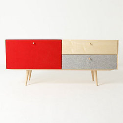 Chroma Console - The unexpected combination of maple, bright red and gray wool felt make this mid-century cabinet a unique piece. Ideal for my TV room, this media cabinet is equipped with an adjustable shelf and holes for power cords. Now, there is no reason why one should sacrifice design and beauty for functionality.