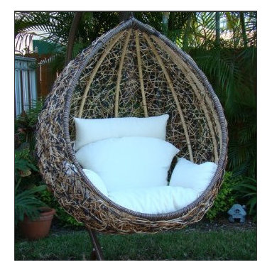 Egg Swing Chair - This egg chair looks like a fluffy throne. The weave on the egg is truly different and I love how the white cushion offsets it. It looks like super comfort to me.