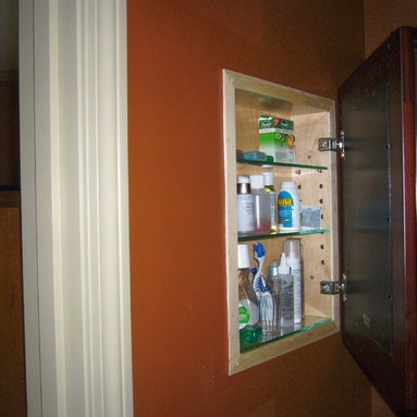 Recessed Picture Frame Medicine Cabinets with No Mirrors - Large Espresso Concealed Cabinet with natural interior from ConcealedCabinet.com.  You insert your own artwork and change it as often as you like!