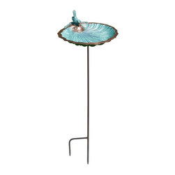 Minuteman International - Scallop Shell Bird Bath - BBM-01-S - Shop for Garden Bird Baths from Hayneedle.com! Give your feathered friends a treat with the Scallop Shell Bird Bath. Plant it in your yard or garden on the included stake. Easy to clean the bowl can be removed from its stake. It s crafted from antique brass for durability and strength. Making it more attractive is the Verdi finish that lends it a traditional appeal. You can use this versatile piece as a feeder as well. Keep this bowl by a flowerbed or vegetable patch and enjoy watching the birds as they bathe or drink from it.About ACHLA DesignsThis item is created by ACHLA Designs. ACHLA is a garden accessories company that emphasizes unique wood and hand-forged wrought iron European furnishings for the home and garden. ACHLA Designs continues to add beautiful and unique items year after year resulting in an unusually large product line. All ACHLA products are stocked in the company's warehouse for year-round prompt shipping. ACHLA Designs takes great pride in offering exceptional products and customer service.