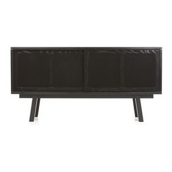 Bryant Black Large Sideboard - Destined to become a Crate and Barrel classic, Bryant can be used in most any room for all kinds of reasons, and its handsome black finish is definitely d�cor accommodating. Sized high like a console table, this handsome piece not only opens its sliding doors to store extra dishes and table linens, it can also serve as a buffet table or bar. Cord management cutouts make it easy to store entertainment media.