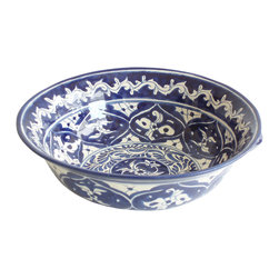 Via Azul Salad Bowl - With their vibrant, colorful patterns and hand-crafted charm, Mexican ceramic bowls reflect the warmth of their culture and landscape, adding some cozy spice to the table. This bowl's blue and white floral pattern is striking yet versatile; it looks great on the wood table and is certain to make your food look pretty. It has two small handles for a final, unique touch of character.