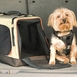 Frontgate - Wander Pet Carrier - Padded, adjustable, removable shoulder strap for comfortable carrying. Interior tether provides a secure attachment to harness. Machine-washable, padded liner keeps interior clean and your pet comfortable. Doubles as a mobile pet crate. Entire carrier is collapsible and expandable. Our Wander Pet Carrier makes it easier than ever to bring your favorite small pooch with you wherever you go. This pet carrier is the perfect travel crate for dogs on the go.. . . . . Side pockets for take-along essentials. Can be buckled into a seatbelt. Made of durable polyester in khaki and black with orange trim. For dogs up to 18 lbs.