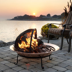 Fire Pit with Half Spark Screen - To fully dome or half dome, that is the question! This deep basin fire pit on in its own stand offers more room for fire starter and a roll top spark screen when a poker may be required. Wrought iron and hand hammered steel with a Mayan inspired raised relief around the basin rim. Stunning!