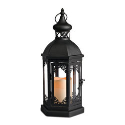 Marrakech Lantern - I've never been to Morocco, but this lantern makes me want to visit soon. Add a touch of Moroccan flair and mood lighting to your backyard party with this stylish and functional Marrakech lantern.