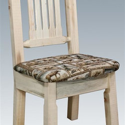Montana Woodworks - Handcrafted Dining Chair - Sawn square timbers and trim pieces for rustic timber frame design. Heirloom quality. Upholstery seat in the wildlife pattern. Solid lodge pole pine. Contoured and comfortable seat. Slat style back increases comfort. Made from U.S. solid grown wood. Lacquered finish. Made in U.S.A.. No assembly required. Seat height: 18 in.. Overall: 19 in. W x 18 in. D x 38 in. H (20 lbs.). Warranty. Use and Care InstructionsFrom Montana Woodworks, the largest manufacturer of handcrafted quality log furnishings in America comes the all new Homestead Collection line of furniture products. This wonderful dining or side chair is as comfortable as it is unique. This chair incorporates the tried and true mortise and tenon joinery system that has served as a symbol of durability for millennia. Each piece signed by the artisan who makes it.
