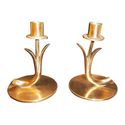Consigned Vintage - A Pair of Small Gunnar Ander Brass Candle Holders - A pair of small brass candle holders designed by Gunnar Ander for Ystad Metal. Top can be unscrewed for cleaning. Gunnar Ander was a Swedish designer known for his stylish work in glass and brass. An architect by profession, he has designed for well known Scandinavian companies including Ystad Metall. There is wear on the bottom.