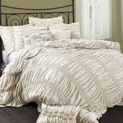 Lush Décor - Ivory Madelynn Comforter Set - This sophisticated set brings a sense of classic style to bedroom décor. With rich embroidery and faux silk fabric, this comforter is sure to create a cozy atmosphere ready for rest and relaxation.   Includes comforter and two shams 100% polyester Dry clean Imported