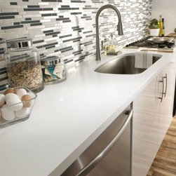 Corian® Designer White countertop featured with sink. - Photo by Dupont