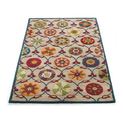 Grandin Road - Wellsboro Area Rug - Richly dimensional area rug with a colorful suzani design. Handcarved wool construction on a jute ground. Cotton backing adds an extra layer of durability. Extend the life of your rug with our Nonslip Rug Grip (sold separately). Our vibrant and sculpted Wellsboro Rug combines a handcarved-wool suzani design, a neutral jute ground, and a narrow indigo wool border. The combination of hand-tufted wool and looped jute creates an impressive texture. .  . . . Imported.