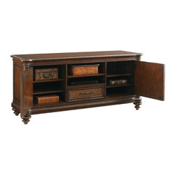 """Frontgate - Cobia Media Console - Offers ultimate function and storage for electronics, with a ventilated back, wire management channel and included grommets for electrical cords. Accommodates the 9000-1-BL Sligh Strong/Arm® TV Mount, which allows the monitor to """"float"""" above the console. Each enclosed cabinet contains two adjustable-height shelves. Open center compartment includes one drawer and one adjustable shelf. Door and drawer fronts feature woven raffia paneling. Enjoy the contrast of today's high-tech wonders, placed in the context of indigenous materials and elegant artistry. Our Cobia Media Console features refined yet relaxed British West Indies styling. A maple and dark cherry inlaid top is surrounded by an exotic quartered rosewood border and flanked by carved bamboo-style columns. Cabinet doors on each end are finished with woven raffia paneling, a crossing nailhead trim and dramatic door pulls in the shape of a curled crocodile - referencing traditional design elements of Africa, the West Indies and the Pacific Rim.  . Accommodates the 9000-1-BL Sligh Strong/Arm TV Mount, which allows the monitor to """"float"""" above the console .  .  .  . Beautifully carved African crocodile custom door pulls have an antique brass finish . A warm, tobacco-hued Sumatra finish highlights beautiful variations in each material . Coordinates with other items from our Tommy Bahama Landara collection ."""