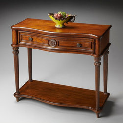 Butler - Butler Plantation Cherry Console Table In Vintage Oak - Selected solid woods  wood products and choice veneers. Cherry veneer top  sides  drawer front and lower display shelf. Drawer with resin applique and antique brass finished hardware.