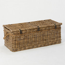 Rattan Trunk Basket - Stow away pillows, extra bedding or dirty clothes in this rattan trunk placed at the end of the bed.
