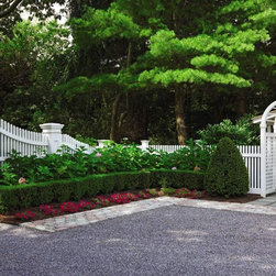 Fence and outside structures near the coast - Sloping picket fence and Arbor with gate.