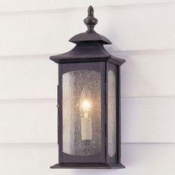 Murray Feiss Market Square Outdoor Wall Lantern - 14H in. Oil Rubbed Bronze - The Murray Feiss Market Square Outdoor Wall Lantern adds a traditional look to your home's patio or porch. This light features an oil-rubbed bronze finish and clear seeded-glass shades. For ample outdoor lighting use one 60-watt C bulb. Clean the fixture with a damp cloth and mild soapy water and the shades with household glass cleaner. This light measures 14H x 5.5W x 4.25D inches.About Murray Feiss LightingThree generations have built Murray Feiss as a renowned name in lighting and it now stands as a leader with a reputation for impeccable craftsmanship innovative design and honest value. Murray Feiss prides itself as the foremost designer and manufacturer of interior and exterior lighting and home decor in the lighting industry. Over 3 800 skilled artists and technicians bring Murray Feiss designs to life meticulously finishing and quality-testing each exclusive product. Murray Feiss Lighting has expanded its extensive copyrighted line of products to include grand chandeliers casual fixtures vanity bath lights with coordinated bath hardware outdoor lighting lamps torchieres wall brackets mirrors and decorative accessories. Whether outdoor or in lighting from Murray Feiss means high quality and innovation.