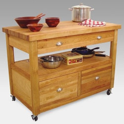 Grand Americana Kitchen Cart & Workcenter - The Grand Americana Workcenter pays tribute to classic American craftsmanship, with generous storage space, a sturdy work surface, and timeless style. A food-safe butcher block top crowns this work center. It features a wide top drawer, easy-access open storage shelf, and a pair of deep 11-inch drawers with smooth glides. Designed with the household cook in mind, the Grand Americana will put an end to getting on your knees to search through deep cabinets. This beautiful product is crafted from oil-finished natural yellow birch hardwood, which is indigenous to the Northeastern U.S. and ranges in color from blond to a darker walnut shade; the natural variation in color allows this cart to coordinate with your existing decor. Satin nickel hardware completes the look. Locking caster wheels provide convenient mobility or stationary use as needed.Dimensions:Overall (assembled): 48W x 26D x 35.5H inchesTabletop: 48W x 26D x 1.75H inchesOpen Shelf: 45W x 23.5D x 8.75H inchesTop Drawer: 38.5W x 17D x 5H inchesBottom Drawer: 17W x 18D x 11H inchesThis work center ships ready to assemble. The process is easy, requiring only common household tools. Furniture will be shipped with all other necessary hardware and easy-to-follow instructions.The top of this work center is made for chopping and cutting, and any scratches can be removed with high-grit sandpaper. Recent studies indicate that wood is safer for food preparation than plastic or glass cutting boards; bacteria like salmonella disappear quickly on wood, but tend to live and thrive on plastic. You should always clean your wooden cutting board surface with soapy water, taking care to remove any food particles and dry the board immediately.To maintain the beautiful finish of your butcher block top, always wipe clean with a damp sponge or cloth and use a mild detergent. You should never soak the wood or let water stand for long periods of time, as it affects the grain. Rinse well and towel-dry before applying new oil. We recommend Catskill's Original Butcher Block Oil, although drug store mineral oil can also be effective in sealing wood. Oil will enhance the color of the wood and offer short-term protection. The old adage of oiling the surface once a week for the first month and once a month for the first year is appropriate, imbuing your cart or island with a rich, golden glow.About CatskillBased in Stamford, New York, Catskill Craftsmen is the nation's leading manufacturer of ready-to-assemble kitchen islands, carts, and work centers. Every item is made from naturally self-sustaining, non-endangered North American hardwoods like birch and hard rock maple. Because all sawdust, shavings, and waste materials generated during the manufacturing process are converted into wood pellet fuel, Catskill Craftsmen generates no wood waste. Founded in 1948, this privately held company is dedicated to offering high-quality products at fair prices and the best customer service in the industry.