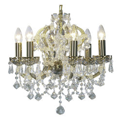 """Inviting Home - Maria Theresa Crystal Chandeliers (Premium Crystal) - clear and gold Maria Theresa style crystal chandelier; 18"""" x 17""""H (6 lights); assembly required; 6 light clear and gold Maria Theresa premium style crystal chandelier with hand-molded arms and cut crystal trimmings; all metal parts have pained gold finish; genuine Czech crystal; * ready to ship in 2 to 3 weeks; * assembly required; This chandelier is a part of Maria Theresa Collection. At their start the chandeliers bearing the name of Maria Theresa were made on the occasion of the Empress's coronation as queen of Bohemia in 1743. This fact is hidden in the shape of these lighting fixtures reminiscent of the royal crown. Their characteristic feature is the arms' typical flat surface clad with glass bars. The bars are fixed to the arms by glass rosettes and beads with dangling cut crystal chandelier trimmings. These ravishing fixtures were inspired by a chandelier made for Maria Theresa in Bohemia in the mid 18th century. However not only the empress became fond of it; so did many others who fancied the style and the majestic manners after her. Typical elements are metal arms overlaid with glass bars and decorated with crystal rosettes. Originally the trimming was made of typical flat drops called """"pendles"""". Today trimmings of various shapes are used. Premium crystal. A sumptuous type of chandelier trimmings. Fire of the rainbow spectrum brilliance limpidity glitter and perfect scattering and dispersion of light - these are their main features resulting from precise cutting using electronically controlled machines but also from high quality crystal containing more then 30% of lead. Traditional mastery and the revealed mystery of the glass substance blend together with modern technologies and first-rate design in each of these unique pieces. Chandeliers dressed with these trimmings of exceptional beauty will lend an air of grandeur to the ambiance even of the most prestigious interiors. Every compon"""