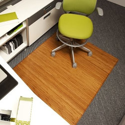 Anji Mountain Natural Bamboo Tri-Fold Office Chair Mat - Your office or home will enjoy this touch of sophistication with the Anji Mountain Natural Bamboo Tri-Fold Office Chair Mat. This machine-made rug is an ecologically friendly alternative to the plain vinyl chair mat. Rubber backing provides cushioning and protects the floor. Folds up for easy transportation. Spot clean. 12 mm. thick.About Anji Mountain Bamboo Rug Co.Anji Mountain Bamboo rugs and office chair mats are ecologically friendly. Bamboo has a robust root system that generates multiple new shoots for every mature stalk that is harvested. Unlike hardwood that can take decades to grow to a mature height ready for harvest bamboo grows 8-12 feet a year! When you purchase a rug or office mat from Anji Mountain Bamboo Rug Co. you help support the ecologically responsible practice of regulating sustainable bamboo forests instead of clear-cutting old-growth hardwood forests.The dense durable bamboo that Anji Mountain Bamboo Rug Co. uses is carbonized and kiln dried to remove moisture which helps prevent cracking and warping. Because of this process their bamboo rugs and office chair mats are ready to withstand the dry heat of your home or office in the wintertime or the arid climate of those living in the desert and mountains.