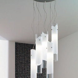 """Vistosi - Vistosi Lio Pendant Light 5 - The Lio 5 pendant light by Vistosi has been designed by Archivio Storico Vetereria Vistosi 1972. These blown glass cylinders were created with technique that enables modeling a white glass band into several layers of crystal. It radiates a glow of light, which is encapsulated within each cylinder. This beautiful light has been handmade on the Venetian island of Murano. Every light comes with a certificate of authenticity.  Product Description: The Lio 5 pendant light by Vistosi has been designed by Archivio Storico Vetereria Vistosi 1972. These blown glass cylinders were created with technique that enables modeling a white glass band into several layers of crystal. It radiates a glow of light, which is encapsulated within each cylinder. This beautiful light has been handmade on the Venetian island of Murano. Every light comes with a certificate of authenticity.                         Manufacturer:             Vistosi                            Designer:                         Archivio Storico Vetereria Vistosi 1972                                         Made in:            Italy                            Dimensions:                         width: 3.1"""" ( 8 cm )  height: 19.1"""" ( 48.5  cm )             overall width: 13.8"""" ( 35 cm)             overall height: 47.2"""" (120 cm)                                         Light bulb:                         5x 100W Halogen or 5 x 23W Flourescent                                         Material                         white with clear crystal"""