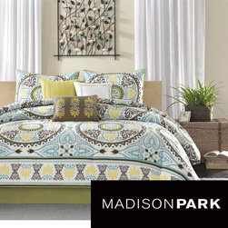 Madison Park - Madison Park Bali 7-piece Comforter Set - The 200 thread count cotton sateen set features dusty shades of green, teal, brown and yellow and beautiful blue medallion motif that repeats across the comforter and is centered on each sham. A matching bedskirt and three pillows are also included.