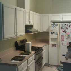Kitchen cabinet painting and vanity repainting. 2011 - These were a honey oak finish originally, we sanded, cleaned and oil-primed them before letting them dry overnight. Then we painted them with Sherwin Williams ProClassic oil enamel. 2-coats.
