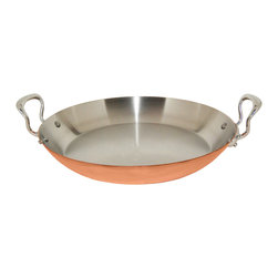 Mauviel M'Heritage M'150s 13.7 Inch Paella Pan - The Mauviel M'Heritage 13.7 Inch Paella Pan allows you to cook with unsurpassed heat conductivity and control thanks to it's 90% copper 10% stainless steel construction. The M'150s collection features classic cast iron handles stainless rivets a polished copper exterior and an 18/10 stainless interior. The cookware has a thickness of 1.5 mm and the copper exterior allows for superior heat conduction and control. The M'Heritage collection represents the total experience and heritage of Mauviel 1830.
