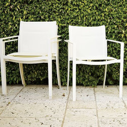 Barrow Armchair - Clean and crisp as a well-chilled cocktail at sunset. Inspired by the poolside parties of Miami and Palm Springs, this modern-minimalist armchair is designed to withstand sun and water with ease, making it perfect for living, relaxing and entertaining alfresco.