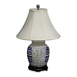 China Furniture and Arts - Blue & White Double Happiness Porcelain Lamp - The quiet beauty of this 18th century design is still highly regarded by collectors today. Double happiness calligraphy symbols are hand-painted on the front and back of this ginger jar-shaped porcelain lamp. Topped with a white silk shade and matching finial. Perfect as a wedding gift. Rosewood base. 95-watt max, bulb not included.