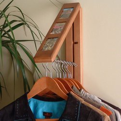 Wood InstaHANGER with Photo Frames - Chestnut Finish - Convenient hanging storage for clothing and outerwear, but folds up into a decorative photo set when not in use, which is especially great if you have a small space and need your wall art to double as utilitarian storage space in a pinch. Provides a full foot of hanging space, can be mounted to just about any surface - also comes in a natural wood finish. 50 pound weight capacity. $34.99