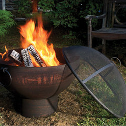 Fire Bowl with Spark Screen - A new twist on the fire pit…it's a fire bowl! Wrought iron and hand-hammered steel with ring handles for portability and a mesh spark screen that you choose when to use. Black with copper accents, and just as dramatic when filled with lush plants in warmer months.