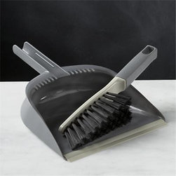 Casabella® Grey Dustpan and Brush Set - Clean floors begin with this clever duster set from Casabella®, created exclusively for Clean Slate™. Thoughtfully designed pan with a deep well and ergonomic prongs keeps contents from floating out, while the rubber lip seals securely to the floor, preventing debris from getting swept underneath. Two-toned brush with rugged bristles snaps in for convenient storage and hangs from opening once you're finished.