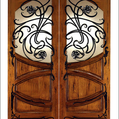 Art Nouveau Entry Doors Model # AN-2002 - Art Nouveau is an art, style, and architecture recognized around the globe.  This door and collection will set you apart from the rest while giving your home a very unique look.  These doors have fine carvings, iron work and most have a operable glass panel to facilitated the cleaning of the iron panel.  Look at the entire collection to find the right fit!