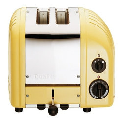 "Dualit - Dualit New Generation Vario 2-Slice Bread Classic Toaster - Canary Yellow - Selector control allows you to heat either one or both slotsSetting for frozen bread, defrost and the option to toast buns and bagels. 2-Slices Insulated Stainless Steel Body 28mm /1.1"" extra wide slots Removable crumb tray and adjustable rear foot Output per hour: 65 slices Loading: 1250 watts. Dimensions: 10"" x 8"" x 9"" high 1-Year Warranty"